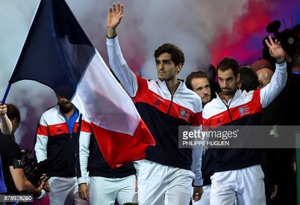 France's team PierreHugues Herbert Lucas Pouille and Richard Gasquet arrive for the doubles match of the Davis Cup World Group final tennis match...