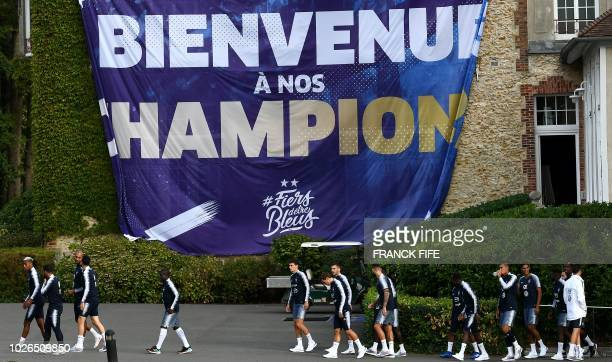 France's team players and members of staff arrive to take part in a training session in ClairefontaineenYvelines on the outskirts of Paris on...