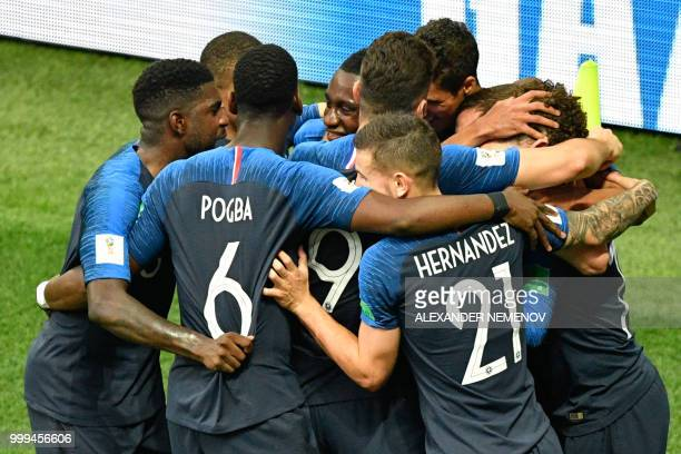 TOPSHOT France's team players celebrate after Croatia's forward Mario Mandzukic scored an own goal on a free kick shot by France's forward Antoine...
