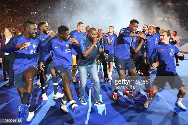 TOPSHOT France's team players celebrate and dance during a ceremony for the victory of the 2018 World Cup at the end of the UEFA Nations League...
