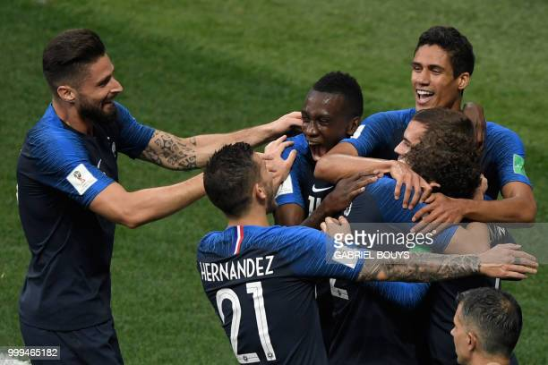 TOPSHOT France's team players celebrate Croatia's forward Mario Mandzukic's own goal during their Russia 2018 World Cup final football match between...