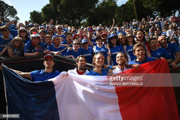 France's team players PierreHugues Herbert Jeremy Chardy Lucas Pouille Adrian Mannarino and Nicolas Mahut celebrate after winning the Davis Cup...