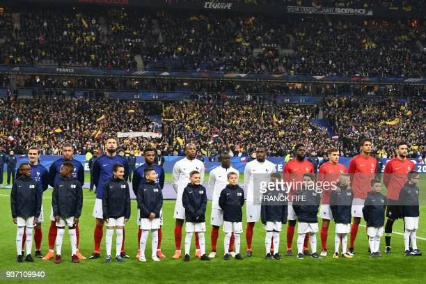France's team players pose during the national anthem prior to the friendly football match between France and Colombia at the Stade de France in...
