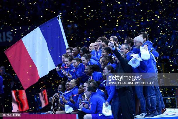 France's team players pose with the trophy and their gold medals on the podium after winning the EHF EURO 2018 European Women's Handball Championship...