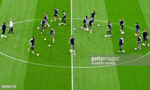 TOPSHOT France's team players warm up as they take part in a training session of France's national football team at the Saint Petersburg Stadium in...