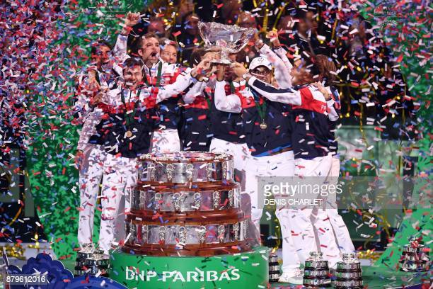 France's team pose with the trophy after winning the Davis Cup World Group final tennis match between France and Belgium at The Pierre Mauroy Stadium...