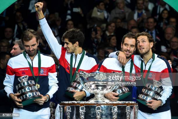 France's team poses with the trophy after winning the Davis Cup World Group final tennis match between France and Belgium at The Pierre Mauroy...