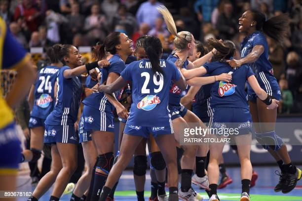 France´s teamplayers celebrate after winning the IHF Womens World Championship handball halffinal match Sweden vs France on December 15 2017 in...