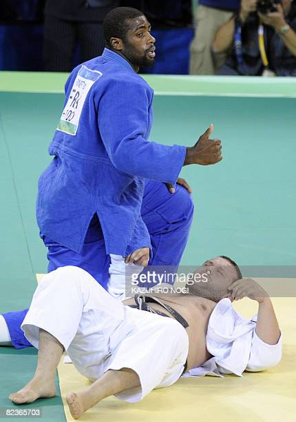 France's Teddy Riner and Georgia's Lasha Gujejiani compete in their men's 100 kgs judo match of the 2008 Beijing Olympic Games on August 15 2008 in...
