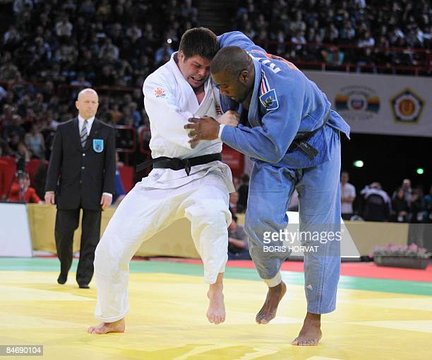 France's Teddy Riner battles with Hungria's Barna Bor on February 8 2009 during their men preliminary round in the 100 kg category on February 8 2009...