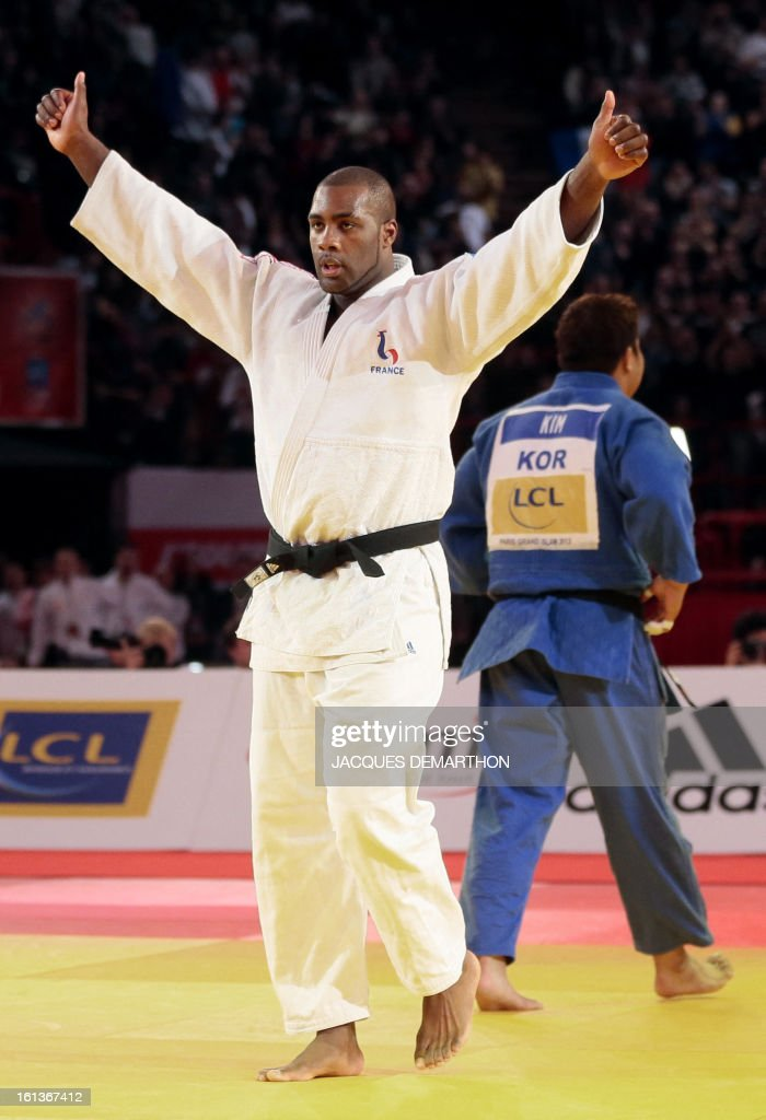 France's Teddy Riner celebrates after beating South Korea's Kim Sung-Min on February 10, 2013, during the Men +100kg final of the Paris International Judo tournament, part of the Grand Slam, at the Palais Omnisports de Paris-Bercy (POPB) in Paris.