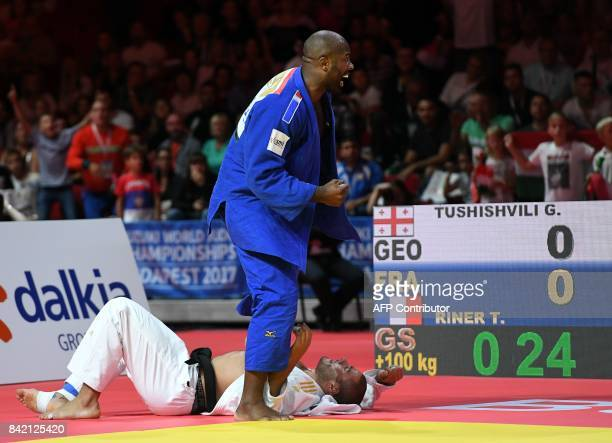 France's Teddy Riner celebrates as he competes with Georgia's Guram Tushishvili in their semi-final match of the mens +100kg category at the World...