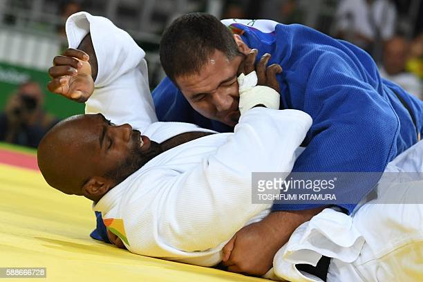 France's Teddy Riner competes with Brazil's Rafael Silva during their men's 100kg judo contest quarterfinal match of the Rio 2016 Olympic Games in...