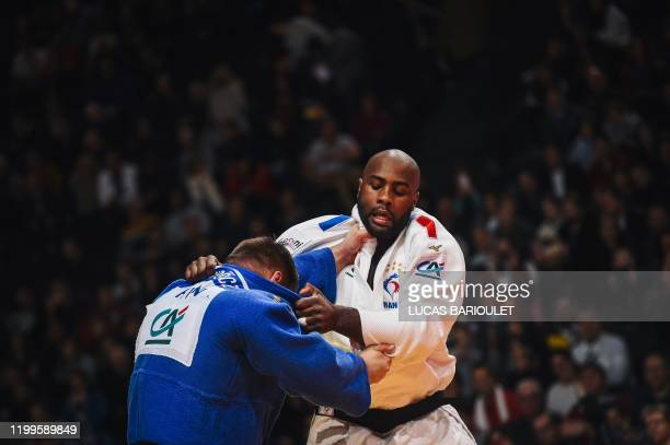 France's Teddy Riner fights against Hungarian Richard Sipocz during a men's over 100 kg category fight at the Judo Paris Grand Slam 2020, in Paris on...