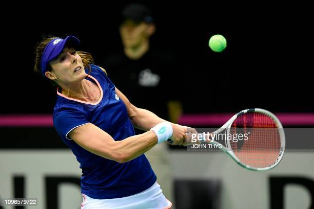 France's tennis player Alize Cornet returns the ball to Belgium's tennis player Elise Mertens during the FedCup World Group first round tennis match...