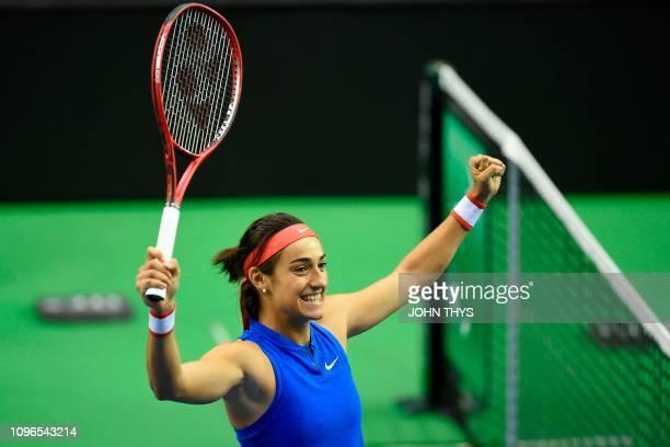 France's tennis player Caroline Garcia celebrates after winning over Belgium's tennis player Alison Van Uytvanck during the FedCup World Group first...