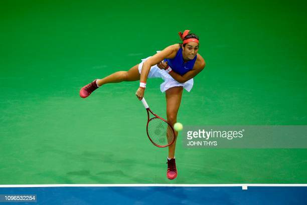 France's tennis player Caroline Garcia serves to Belgium's tennis player Alison Van Uytvanck during the FedCup World Group first round tennis match...