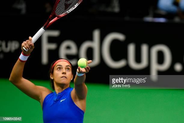 France's tennis player Caroline Garcia serves to Belgium's tennis player Alison Van Uytvanck during the FedCup World Group first round tennis match...