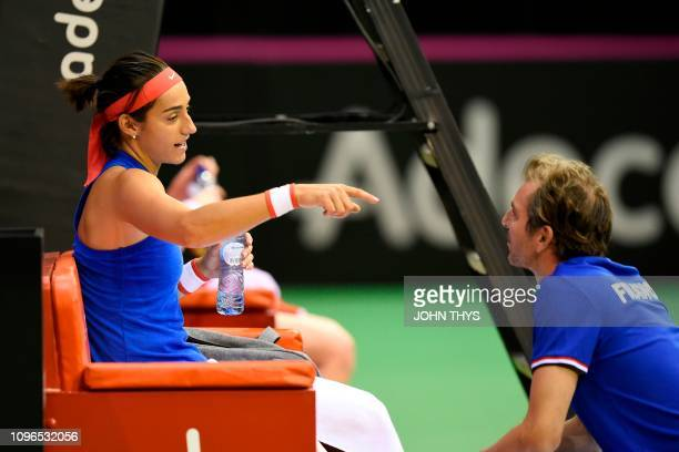 France's tennis player Caroline Garcia talks to France's coach Julien Benneteau during the FedCup World Group first round tennis match between...