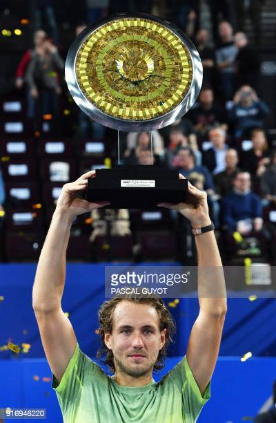 France's tennis player Lucas Pouille poses with his trophy after winning the final of the ATP World Tour Open Sud de France in Montpellier southern...