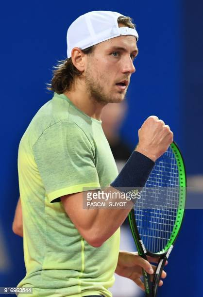 France's tennis player Lucas Pouille reacts after winning the final of the ATP World Tour Open Sud de France in Montpellier southern France on...