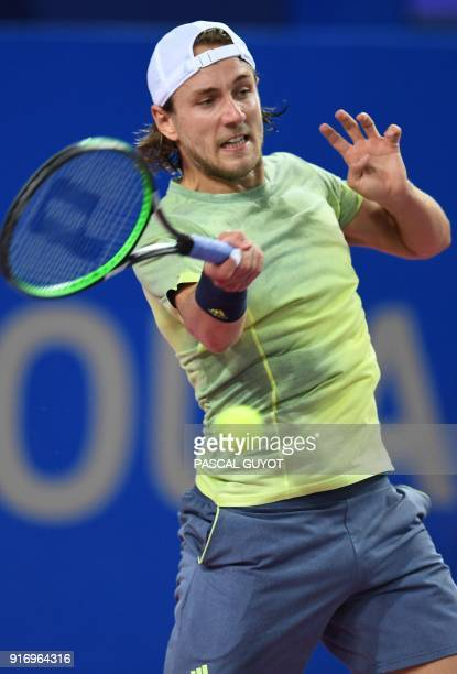 France's tennis player Lucas Pouille returns the ball to France's Richard Gasquet during the final of the ATP World Tour Open Sud de France in...
