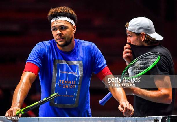 France's tennis players JoWilfried Tsonga and Lucas Pouille attend a training session on November 22 2017 at the PierreMauroy stadium in Villeneuve...