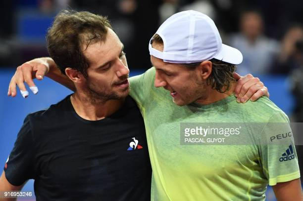 France's tennis players Lucas Pouille and Richard Gasquet embrace after Pouille defeated Gasquet in the final of the ATP World Tour Open Sud de...