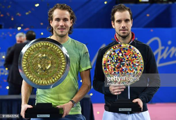 France's tennis players Lucas Pouille and Richard Gasquet pose with their trophy after the final of the ATP World Tour Open Sud de France in...