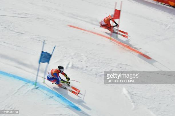 TOPSHOT France's Tessa Worley and Norway's Kristin Lysdahl compete in the Alpine Skiing Team Event small final at the Jeongseon Alpine Center during...