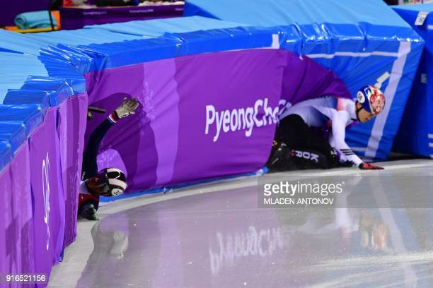 France's Thibaut Fauconnet and South Korea's Hwang Daeheon crash in the men's 1,500m short track speed skating A final event during the Pyeongchang...