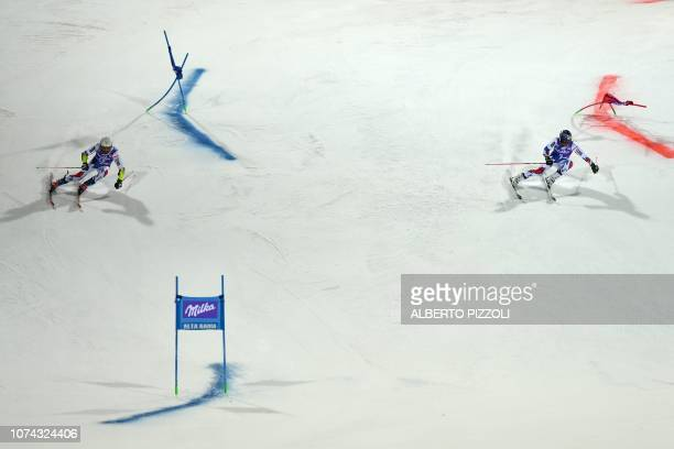 France's Thibaut Favrot and France's Alexis Pinturault compete in the semi-final of the FIS Alpine World Cup Men's Parallel Giant Slalom nightrace on...