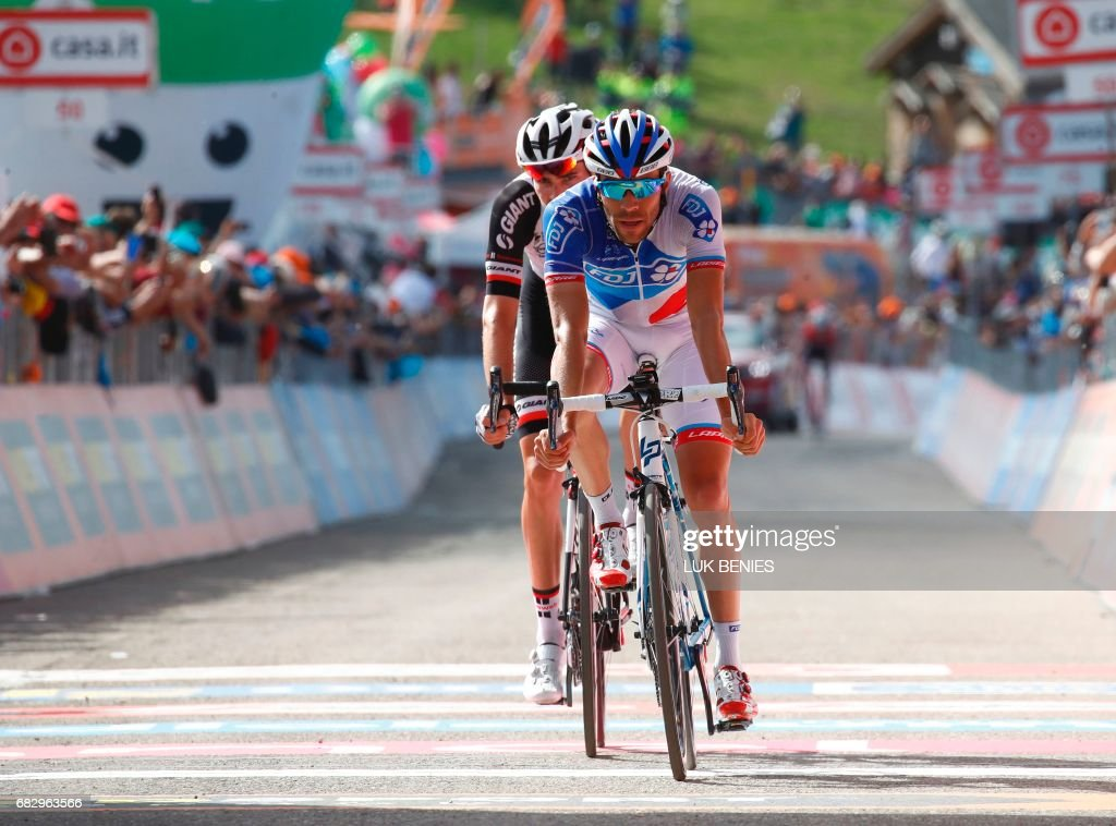 France's Thibaut Pinot (R) and Netherlands' Tom Dumoulin cross the finish line of the 9th stage of the 100th Giro d'Italia, Tour of Italy, cycling race from Montenero di Bisaccia to Blockhaus on May 14, 2017. Colombia's Nairo Quintana soared to victory on a dramatic ninth stage of the Giro d'Italia on Sunday to claim the race leader's pink jersey. Movistar's Quintana came over the finish line 23secs ahead of Frenchman Thibaut Pinot and Dutchman Tom Dumoulin, to wrest the race lead from Luxembourg's Bob Jungels. PHOTO / Luk BENIES