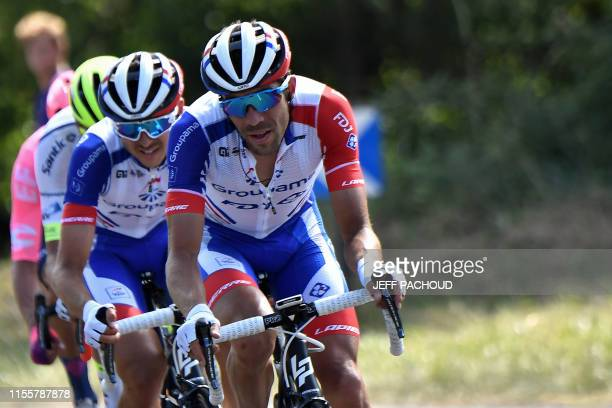 France's Thibaut Pinot and riders keep pulling on in the second group during the tenth stage of the 106th edition of the Tour de France cycling race...