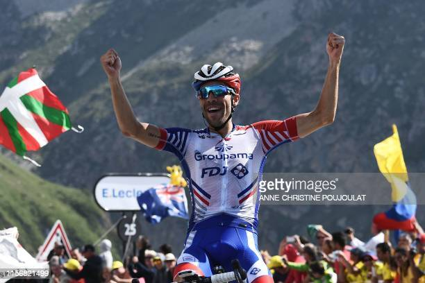France's Thibaut Pinot celebrates as he wins on the finish line of the fourteenth stage of the 106th edition of the Tour de France cycling race...