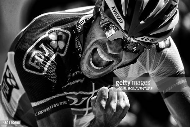 France's Thibaut Pinot celebrates before crossing the finish line at the end of the 1105 km twentieth stage of the 102nd edition of the Tour de...