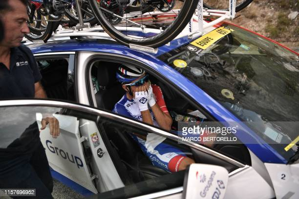 France's Thibaut Pinot, in his team car, reacts after quitting the Tour during the nineteenth stage of the 106th edition of the Tour de France...