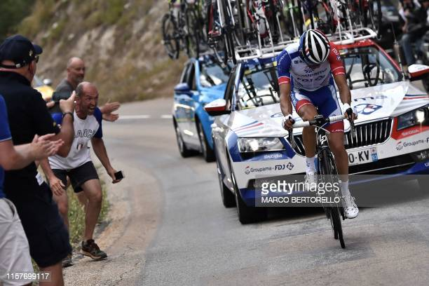 France's Thibaut Pinot rides as he suffers a thigh problem before pulling out the Tour de France during the nineteenth stage of the 106th edition of...
