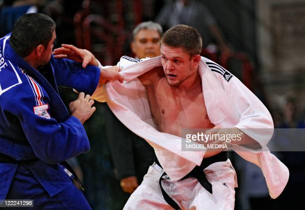 France's Thierry Fabre fights against Kazakhstan's Maxim Rakov during their qualifier match in the 100kg category at the Judo World Championships on...