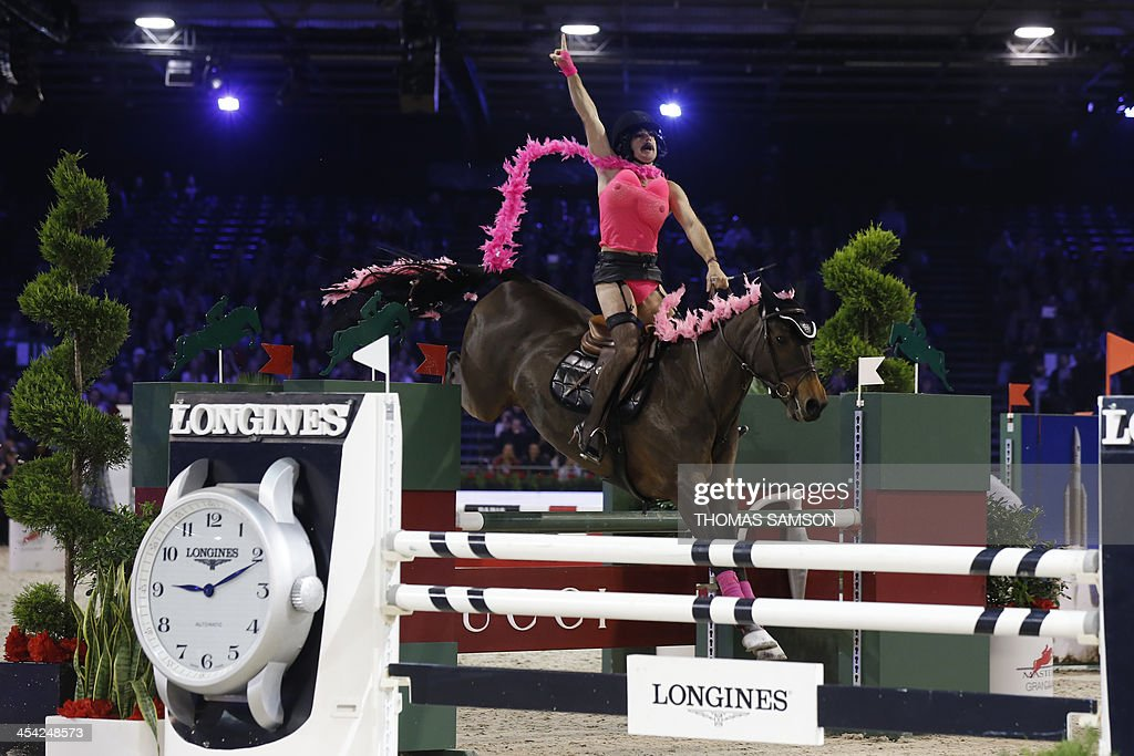France's Thierry Rozier competes in the Style and Competition for Amade charity costumed event of the Paris Masters equestrian jumping competition on December 7, 2013 at the Parc des Expositions in Villepinte, north of Paris. Rozier won the event along with Greece's Electra Niarchos.