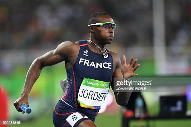 France's Thomas Jordier competes in the Men's 4x400m Relay Round 1 during the athletics event at the Rio 2016 Olympic Games at the Olympic Stadium in...