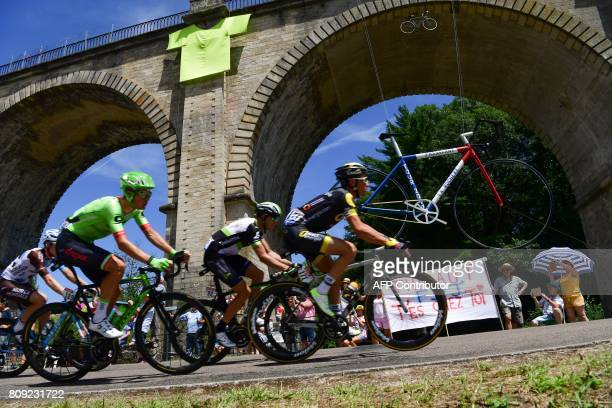 France's Thomas Voeckler Norway's Edvald Boasson Hagen Netherlands' Dylan van Baarle and Belgium's Jan Bakelants ride in a breakaway past a bridge...