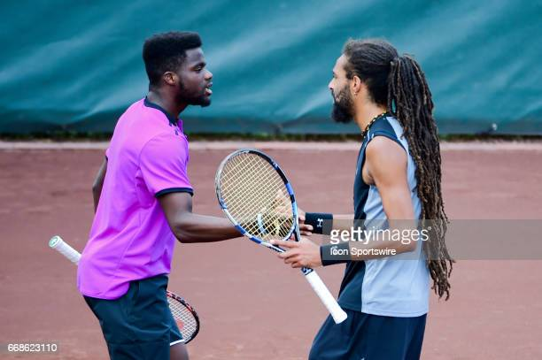 Frances Tiafoe and Dustin Brown shake hands after winning a doubles game during the US Men's Clay Court Championships on April 14 2017 at River Oaks...