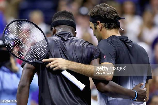 Frances Tiafoe congratulates Roger Federer of Switzerland after their match on Day Two of the 2017 US Open at the USTA Billie Jean King National...