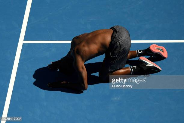 Frances Tiafoe of the United State celebrates winning his fourth round match against Grigor Dimitrov of Bulgaria during day seven of the 2019...