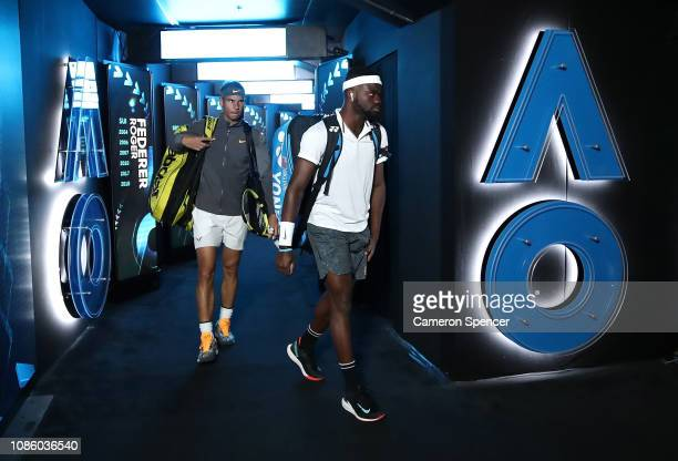 Frances Tiafoe of the United States and Rafael Nadal of Spain walk onto Rod Laver Arena before their quarter final match during day nine of the 2019...