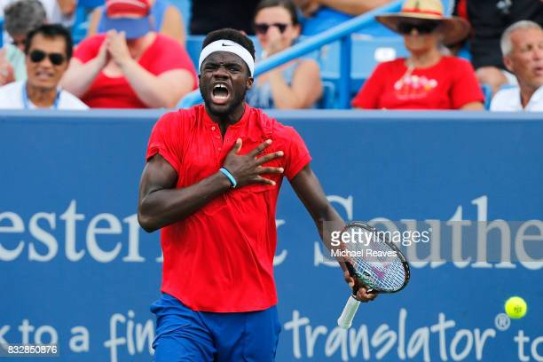 Frances Tiafoe of the United States celebrates after defeating Alexander Zverev of Germany during Day 5 of the Western and Southern Open at the...