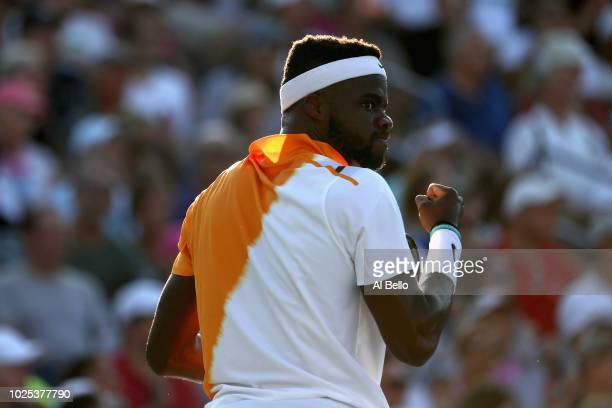 Frances Tiafoe of The United States celebrates during the men's singles second round match against Alex Di Minaur of Australia on Day Four of the...