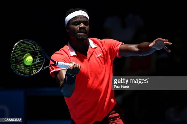 Frances Tiafoe of the United States plays a forehand to Stefanos Tsitsipas of Greece during day three of the 2019 Hopman Cup at RAC Arena on December...
