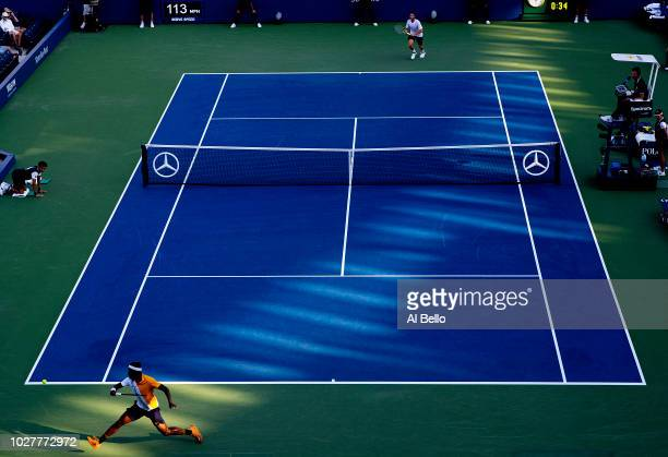 Frances Tiafoe of the United States returns the ball during his men's singles first round match against Adrian Mannarino of France on Day Two of the...